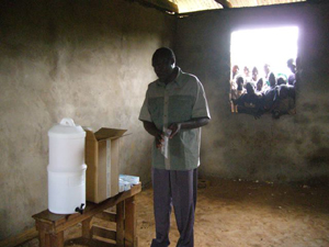 Fred Mango, Jack's African counterpart in the Raincatcher Africa Project, demonstrates how to use the filters. Photo Credit: Jack Rose